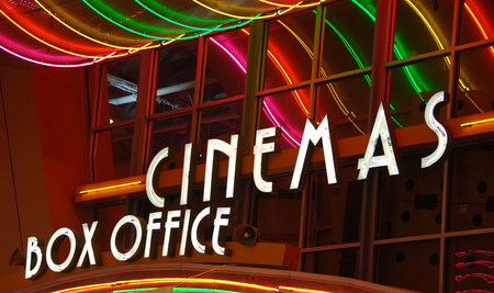 movie theater sign that says Cinemas and Box Office in neon colored lights ... purchased from icholakov - Fotolia.com